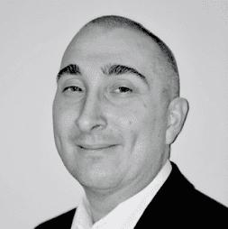 Head and shoulders photo of Simon Perks, head of robotics and AI at Agilisys